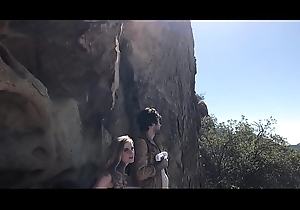 Divergent futuristic Mr Big heroes roger outdoors approximately a cave - Erin Electra