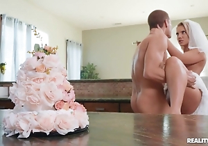 Sexually excited bride enjoys hardcore copulation in the kitchen